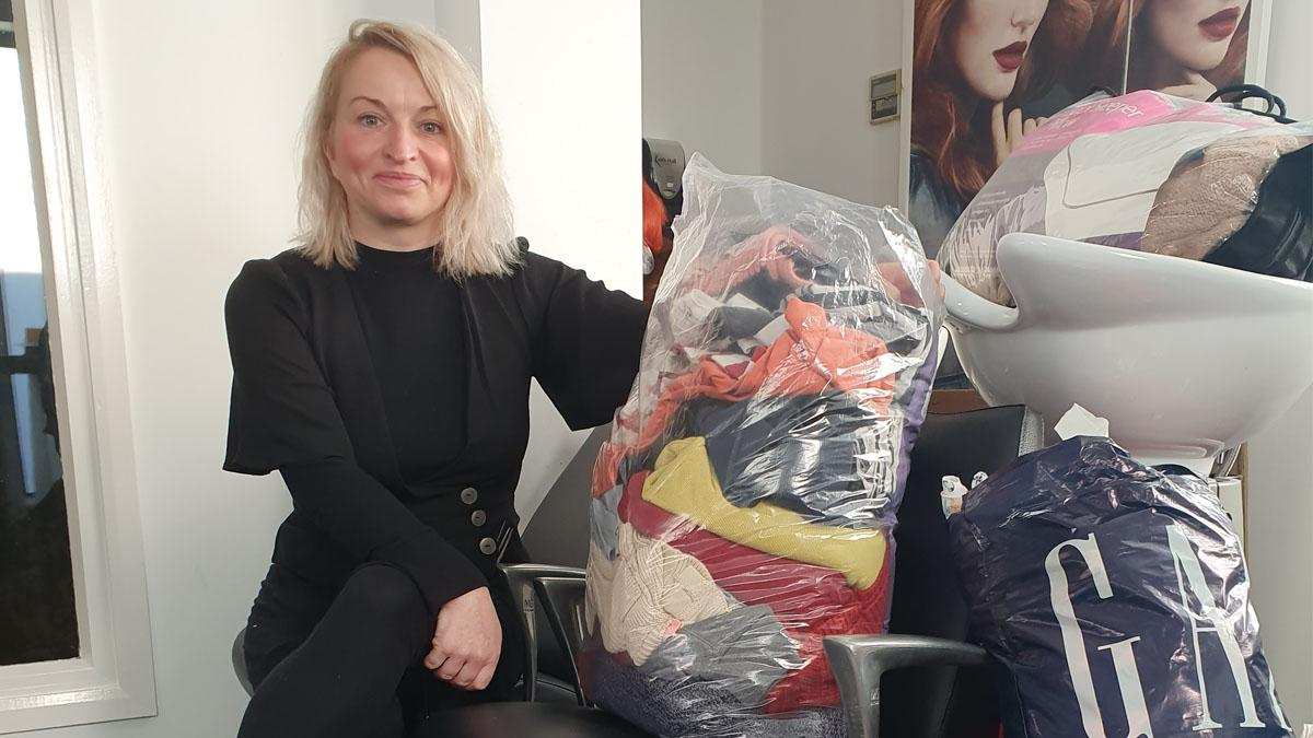 Helen from KH Hair Arnold with donations for homeless